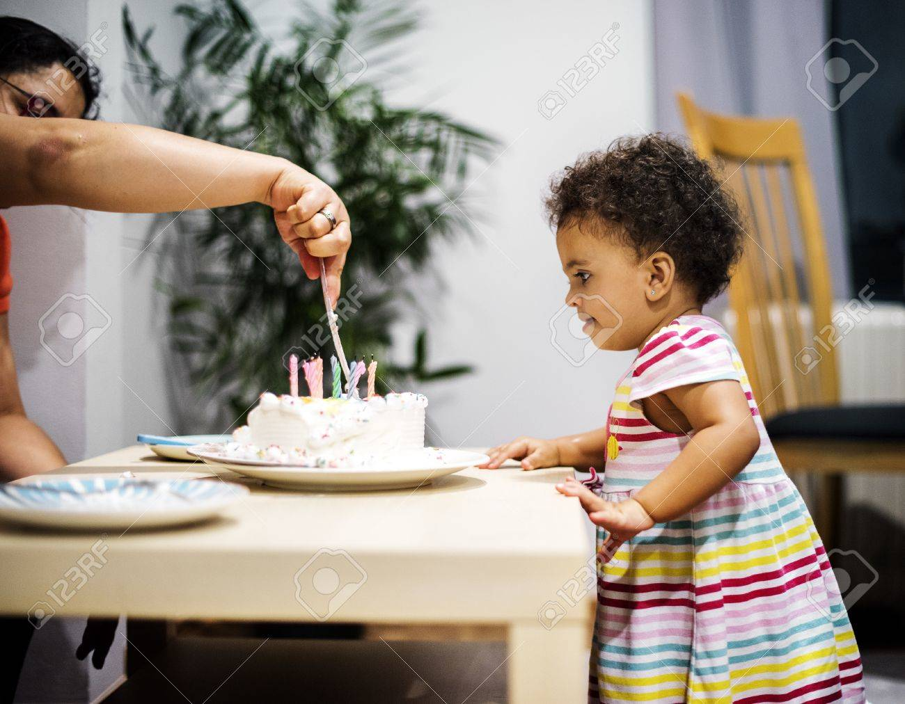 Mother Cutting Birthday Cake For Little Girl Stock Photo Picture