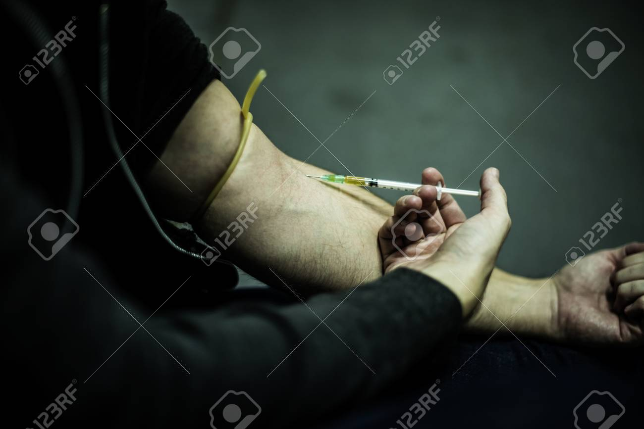 Junkie People Using Syringe Injecting Narcotic Illegal Drugs - 81634981