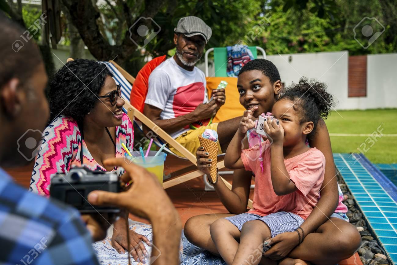 Black Family Enjoying Summer Together At Backyard Stock Photo