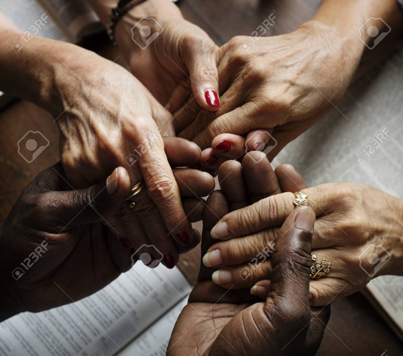 Group of people holding hands praying worship believe - 86192420