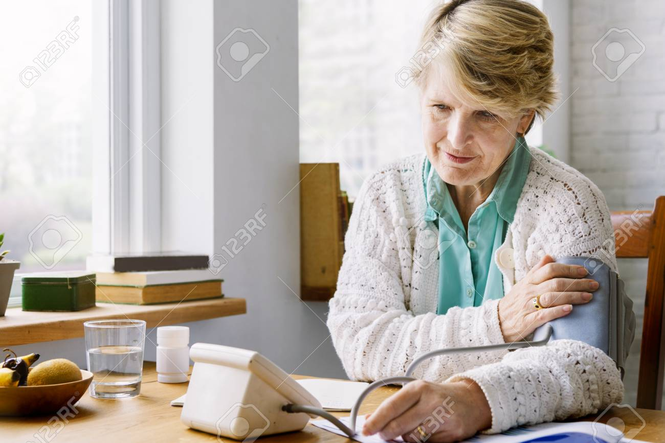 Senior woman checking her own pulse - 89602088