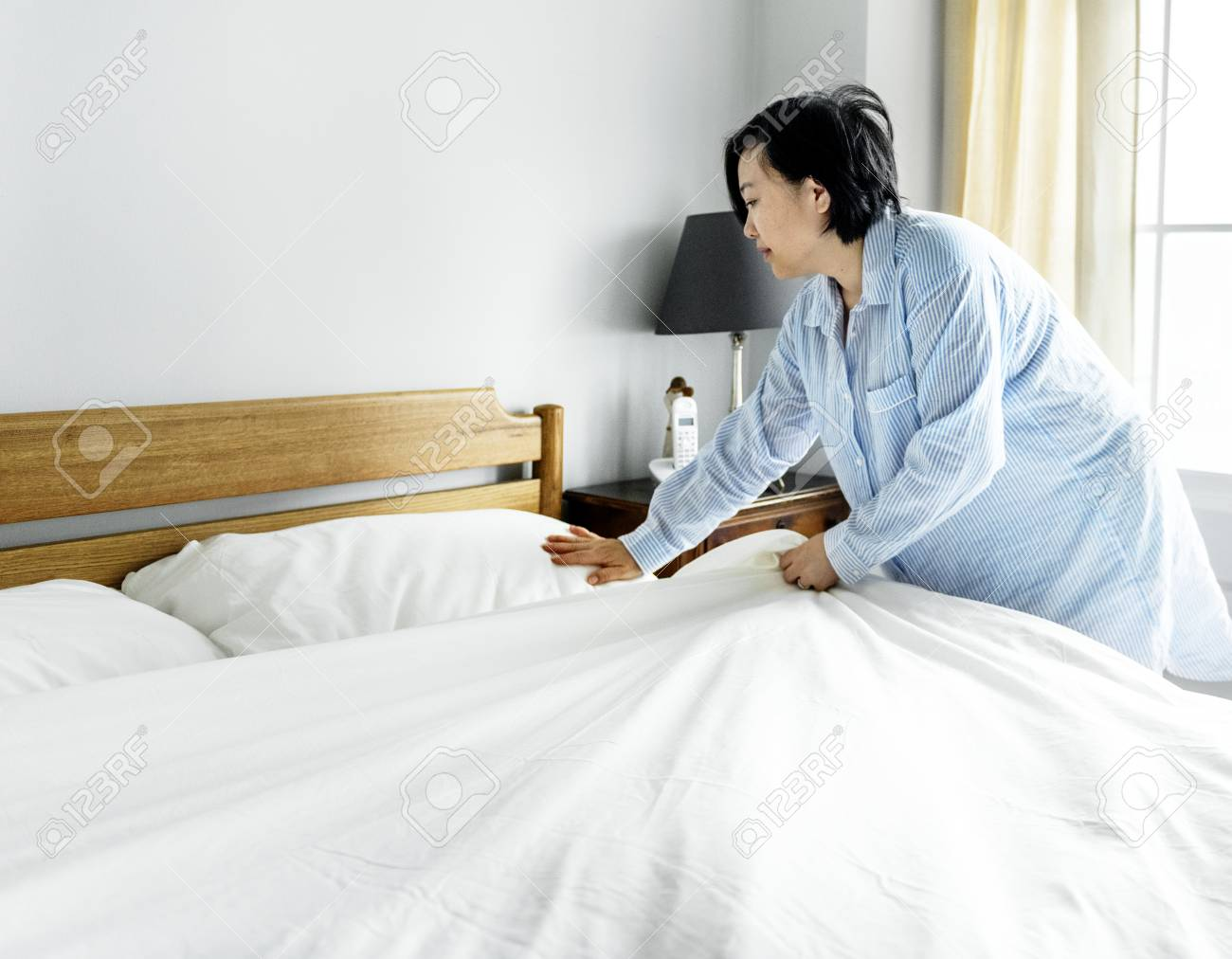 A Woman Making Bed Stock Photo Picture And Royalty Free Image Image 95595899