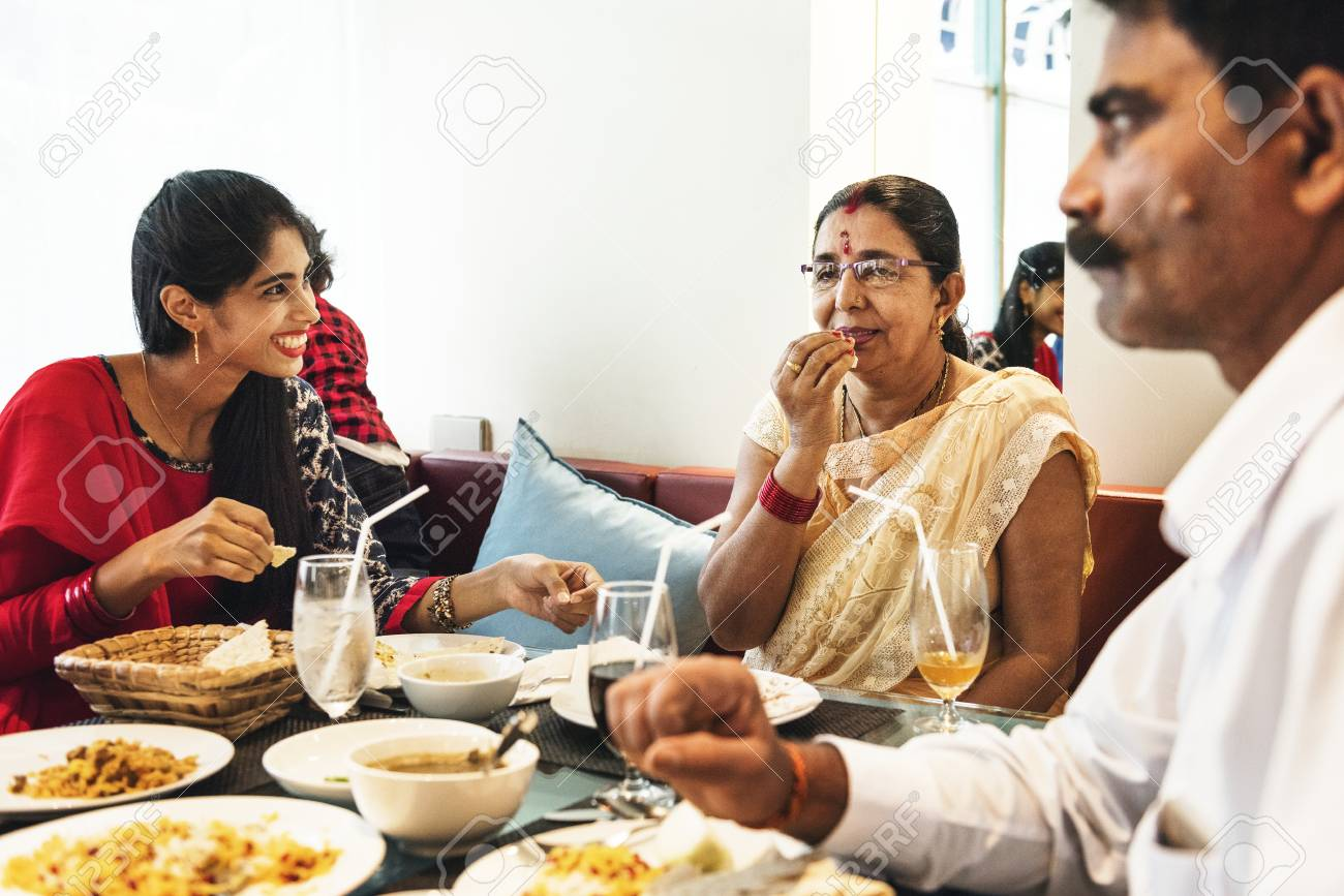 Family having Indian food - 95980528