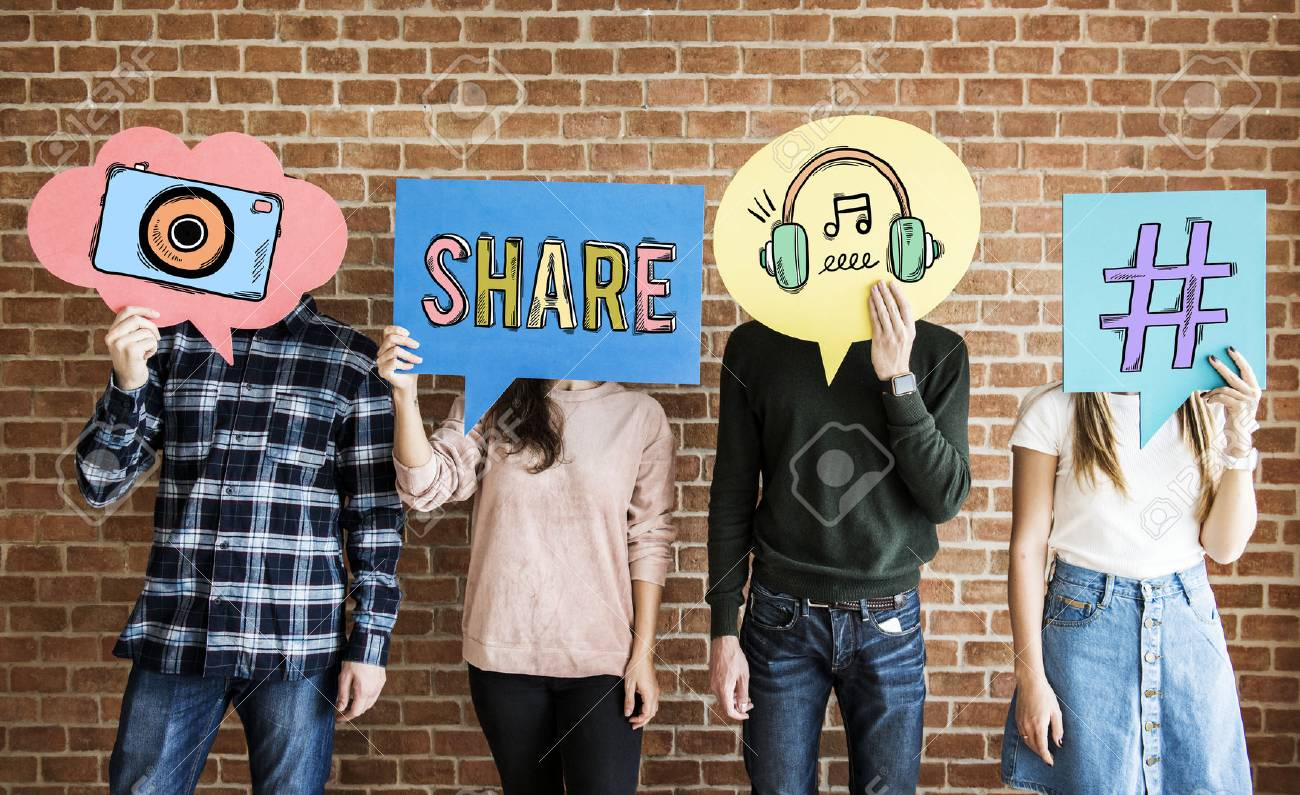 Friends holding up thought bubbles with social media concept icons - 96798097