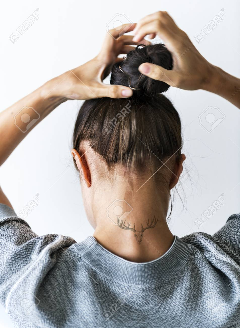 Woman Putting Her Hair Up In A Bun Stock Photo, Picture And Royalty ...