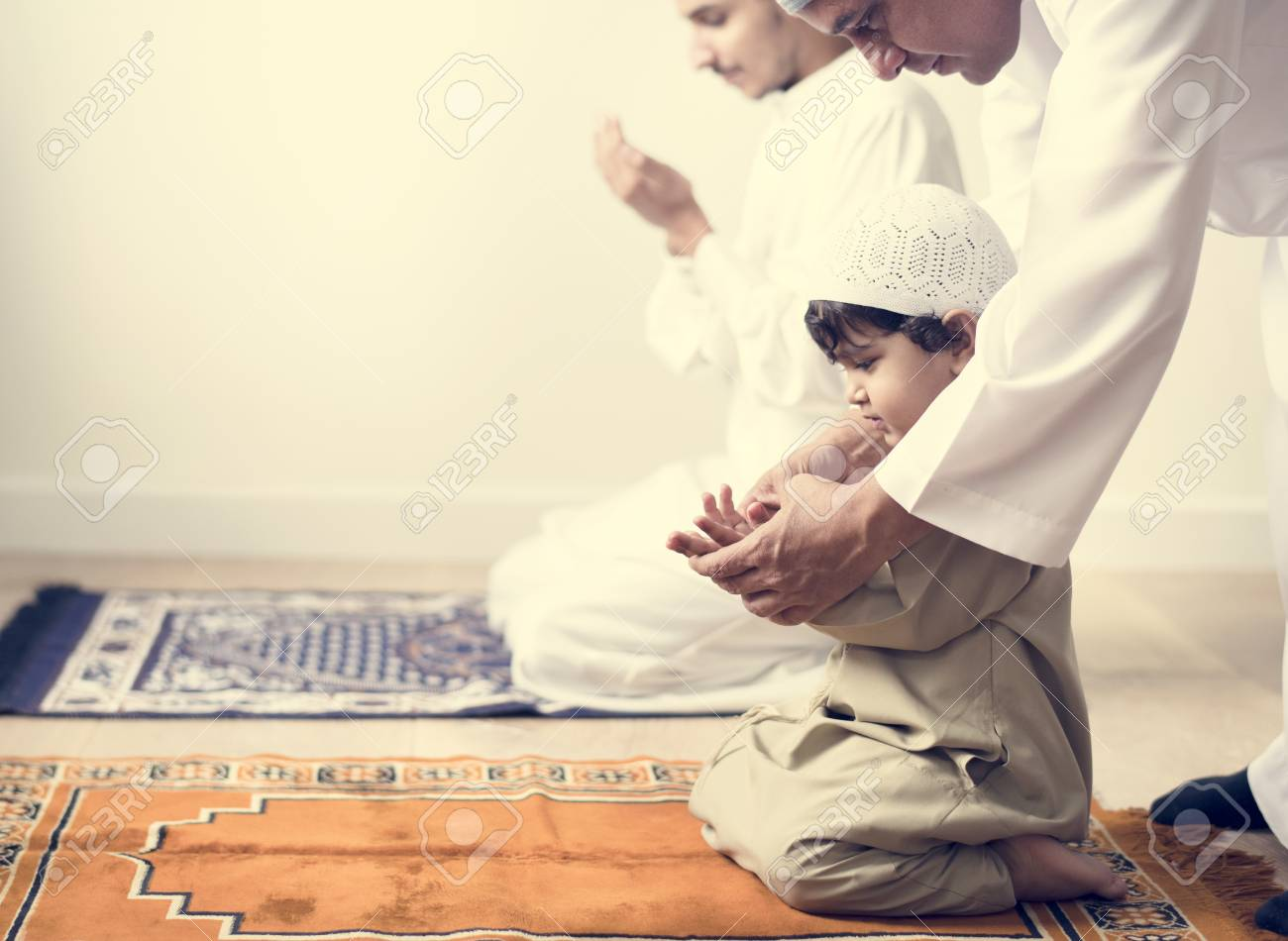 Muslim boy learning how to make Dua to Allah - 102863697