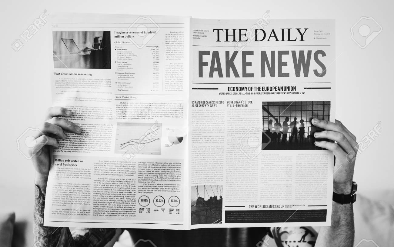 Fake news headline on a newspaper - 104049284