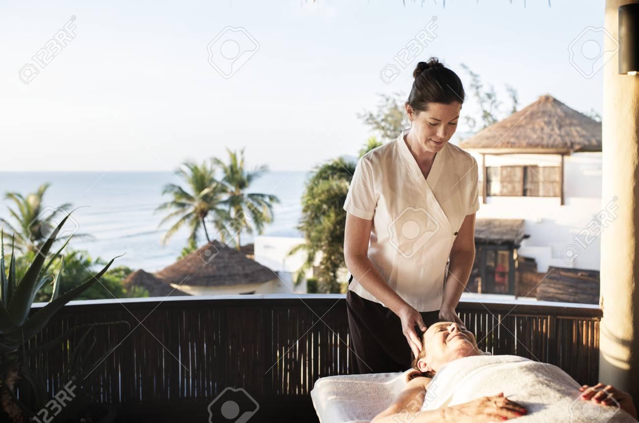 Massage therapist massaging at a spa - 106301208
