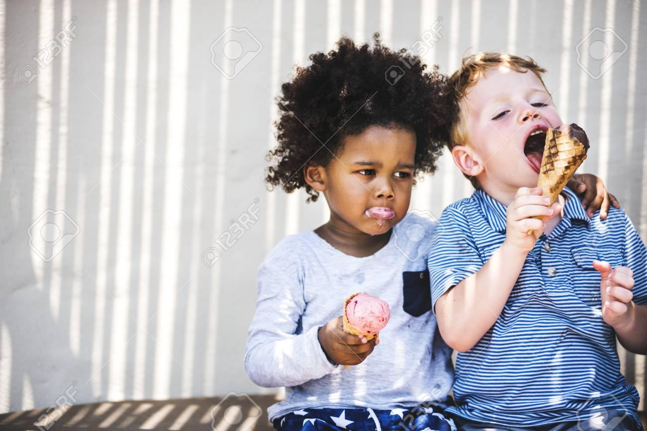 Little kids eating yummy ice cream - 106301681