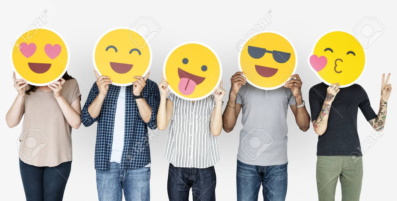 Diverse people holding happy emoticons - 108321700