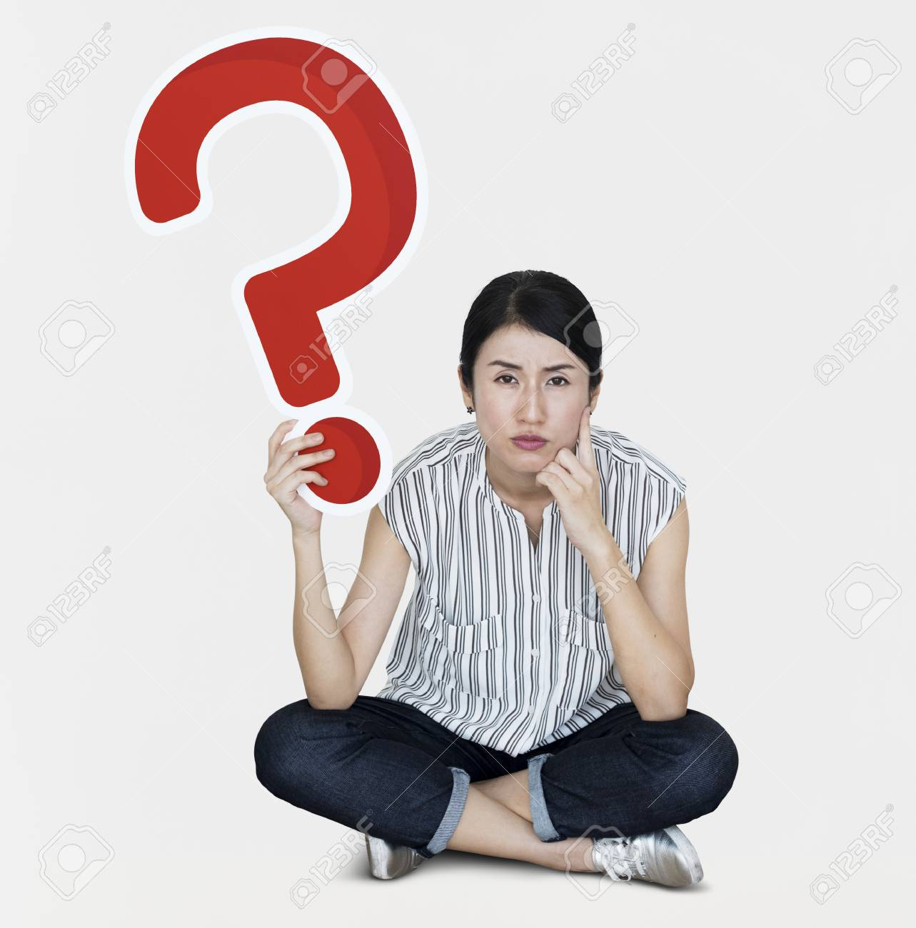 Confused woman holding a question mark icon - 108319597