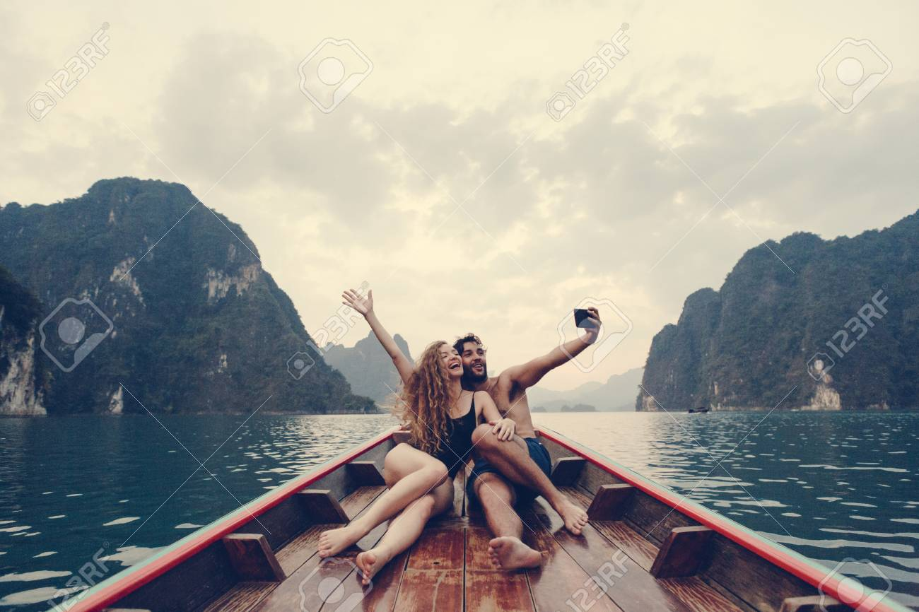 Couple taking selfie on a longtail boat - 109644446