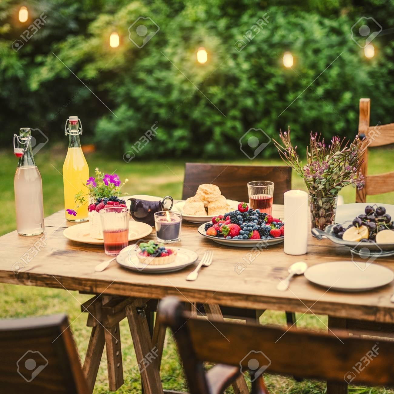 Dinner table set in the garden - 110097451