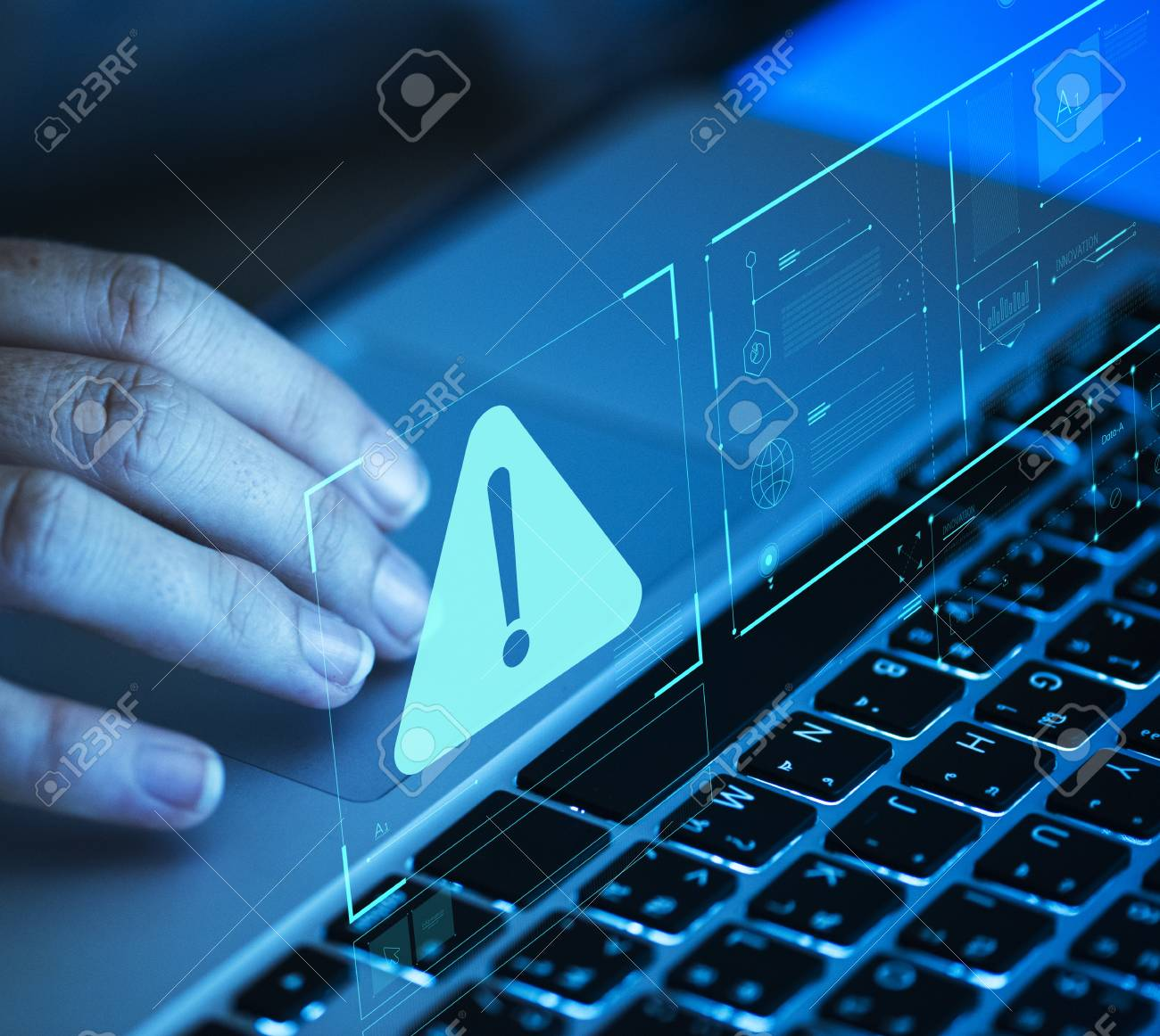 Woman scrolling on a laptop - 110449727