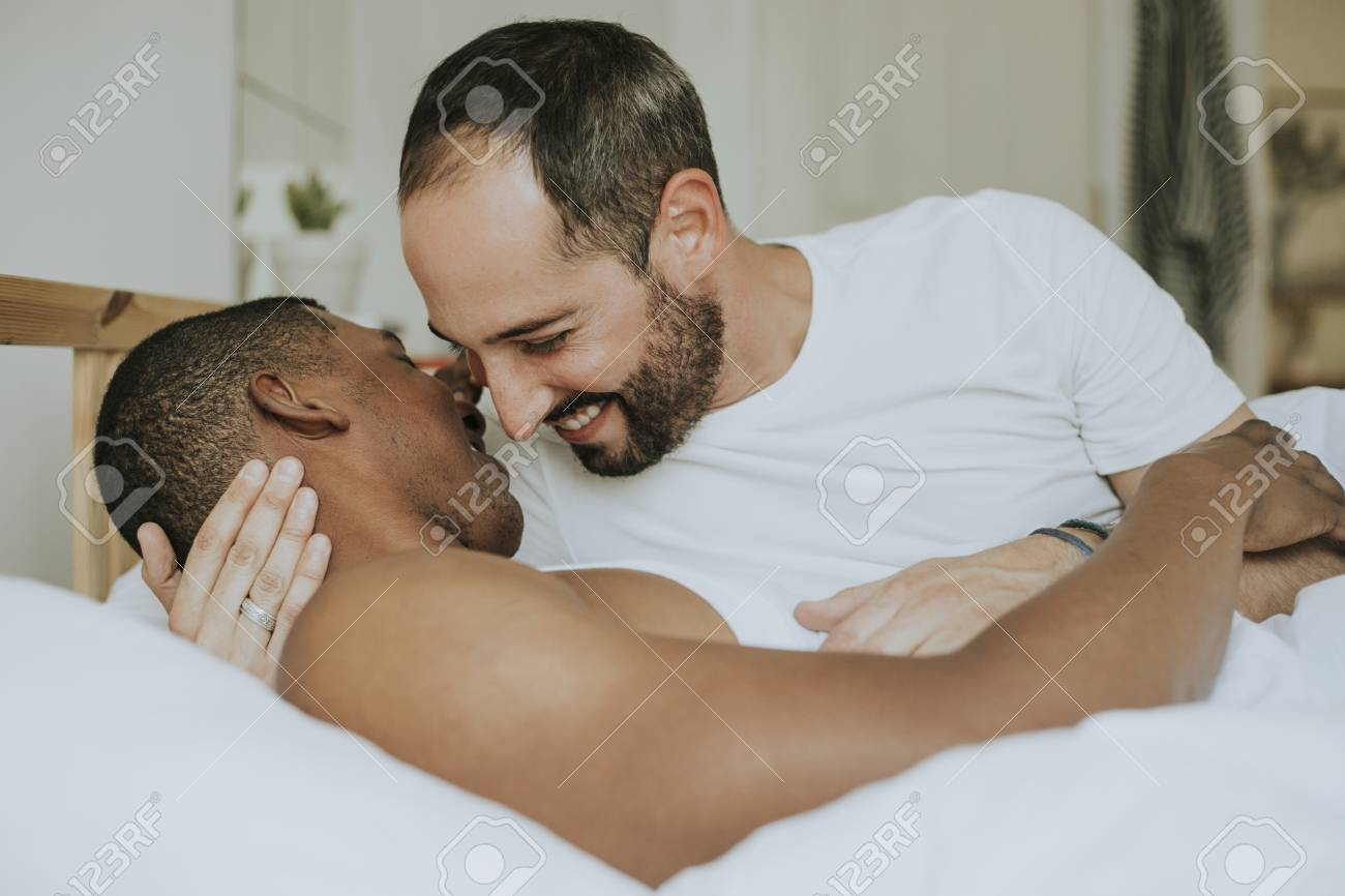 Couple making out in bed