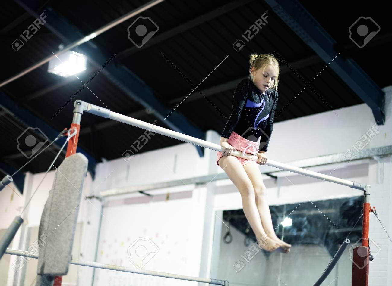 Young gymnast on a horizontal bar - 113301015