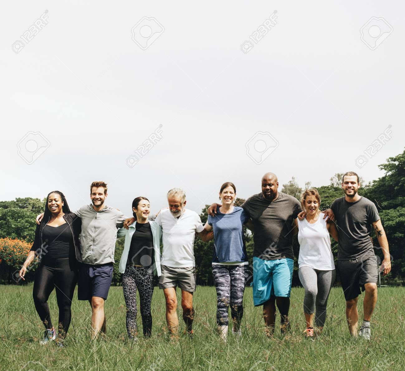 Group of people hugging each other in the park - 112593702