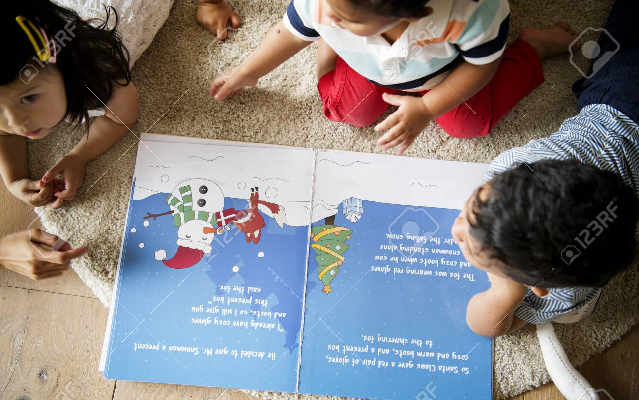 Young kids reading a Christmas story together - 113891372