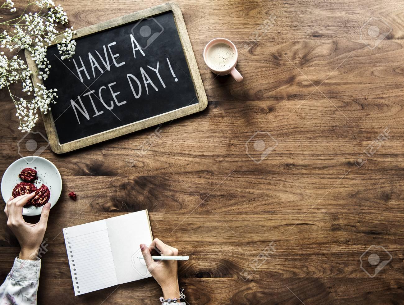Have a nice day phrase written on a blackboard - 115861253