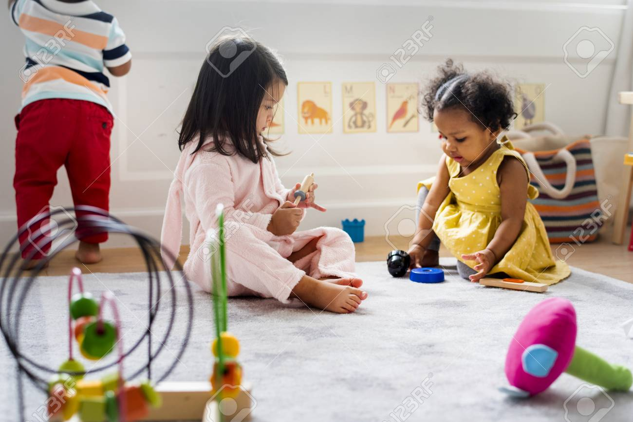 Little kids playing toys in the playroom - 116620531