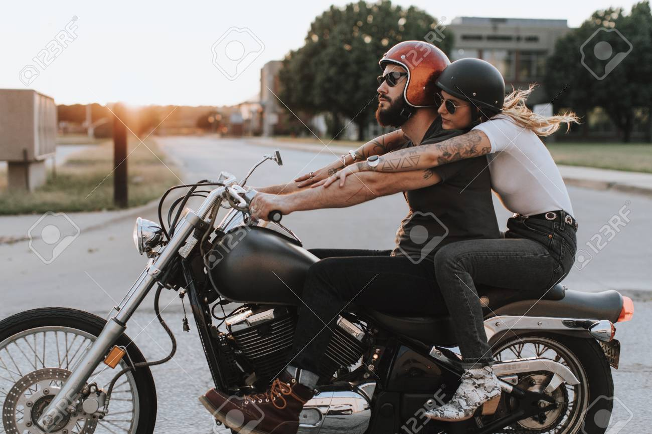 Biker Couple Riding Down The Road In The Sunset Stock Photo Picture And Royalty Free Image Image 117112047