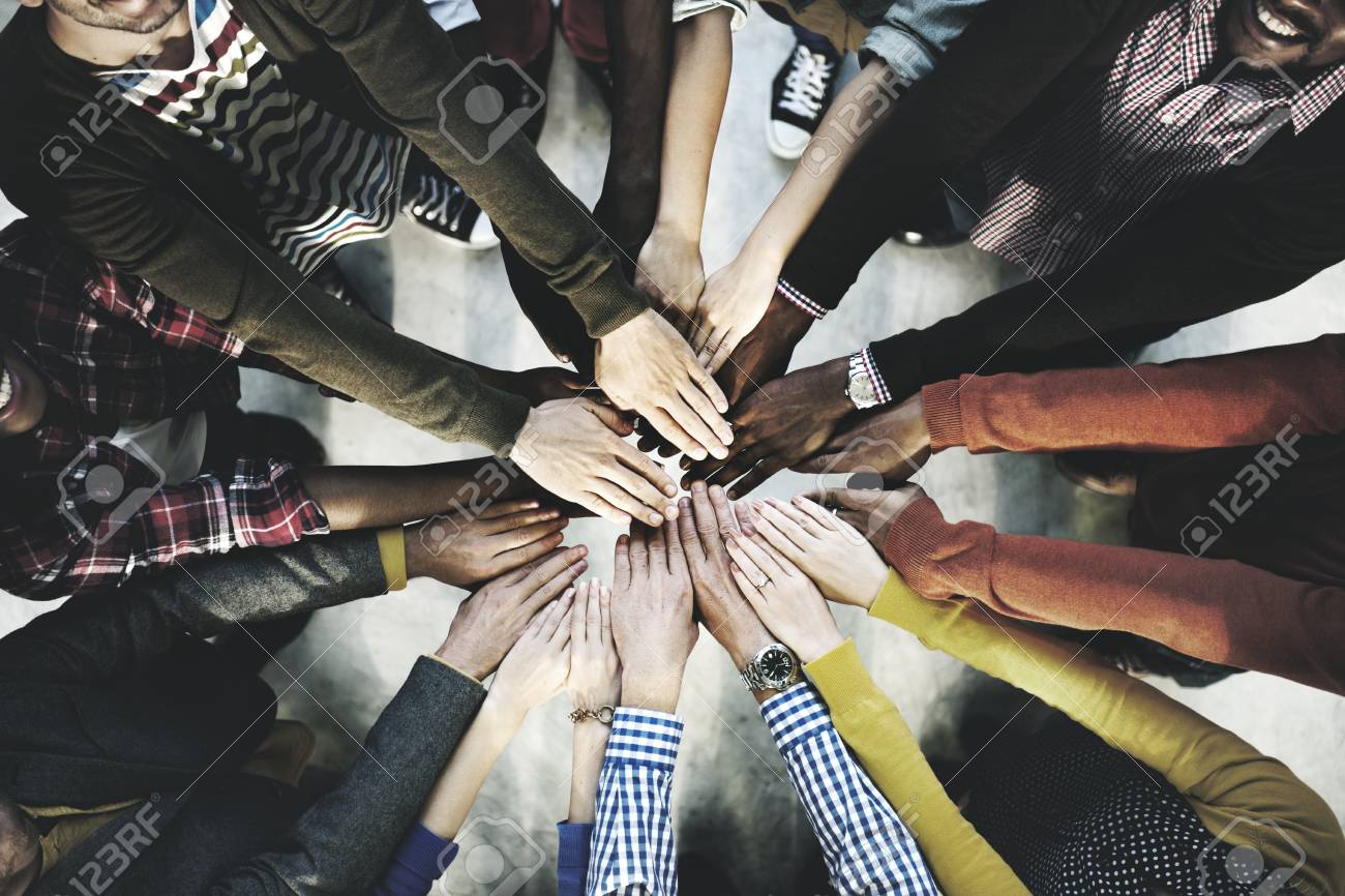 Aerial view of diverse people stacking hands in the middle - 120559588