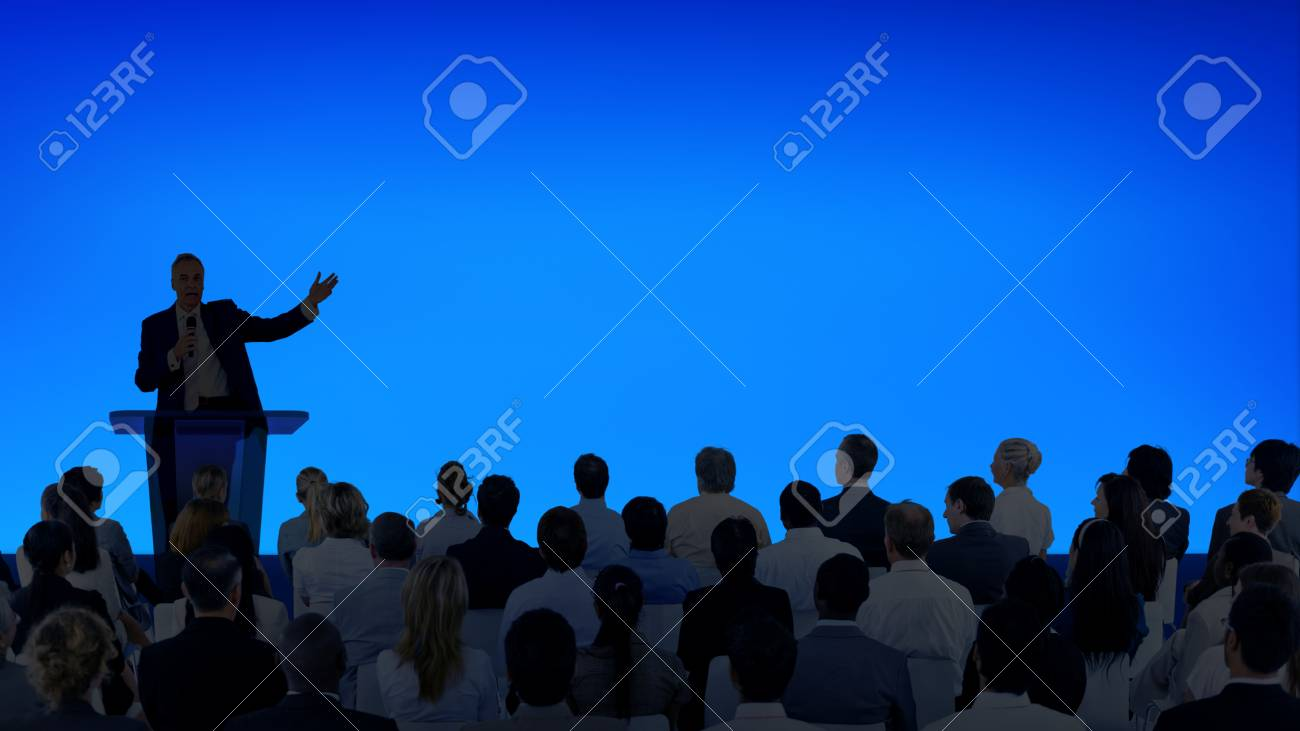 Corporate businessman giving a presentation to a large audience - 120560752