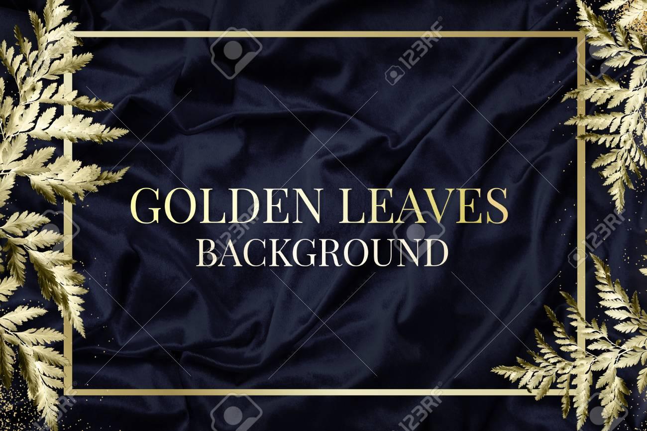 Gold leatherleaf fern frame on navy blue silk textured background illustration - 123595712