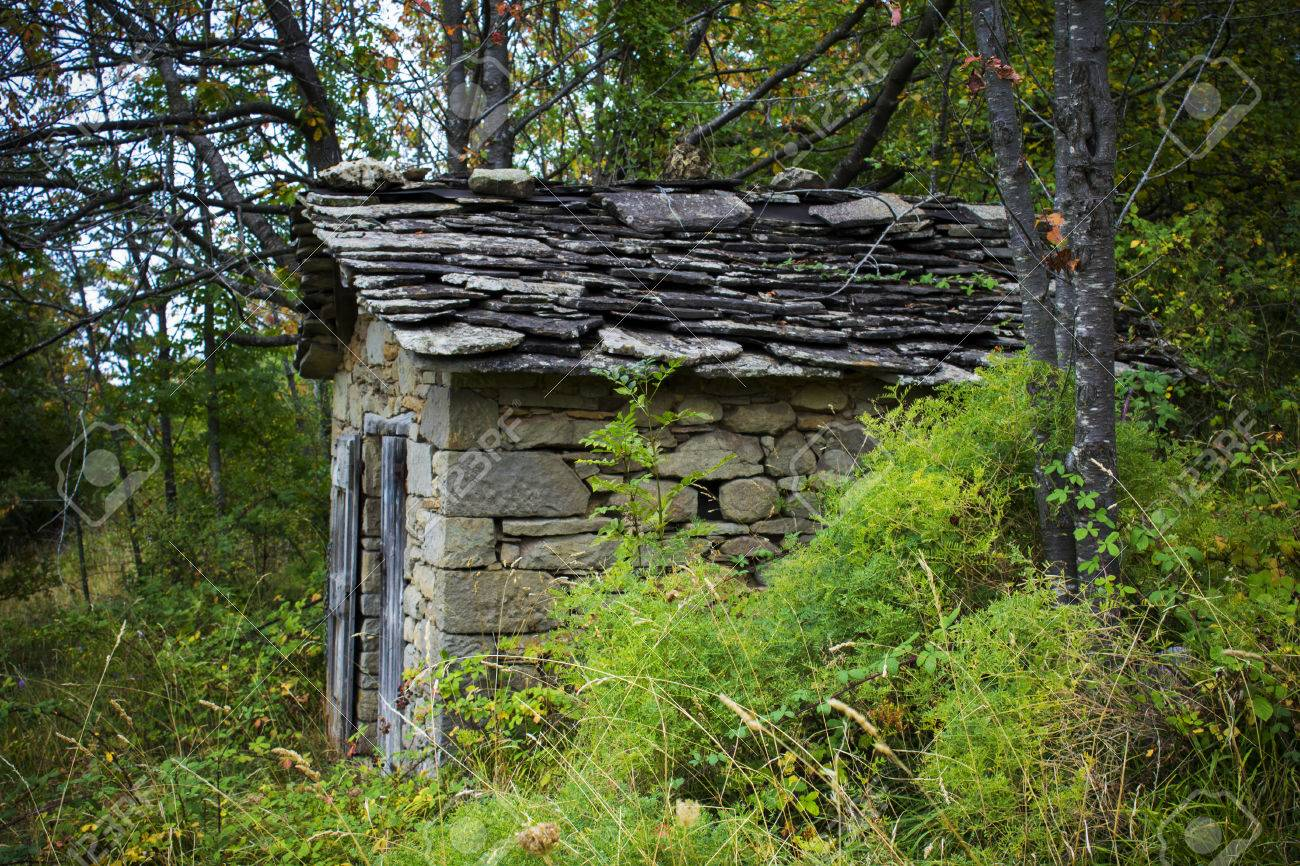 Abandoned Old Stone House In The Woods Stock Photo