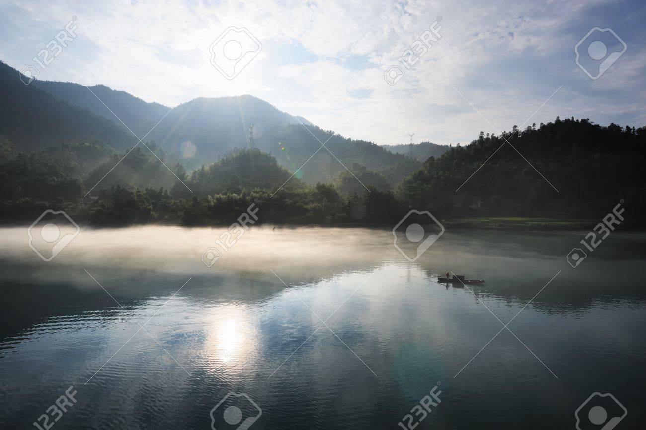 Morning fog rolls across the chilly river water, photo taken in hunan province of China Stock Photo - 8401636