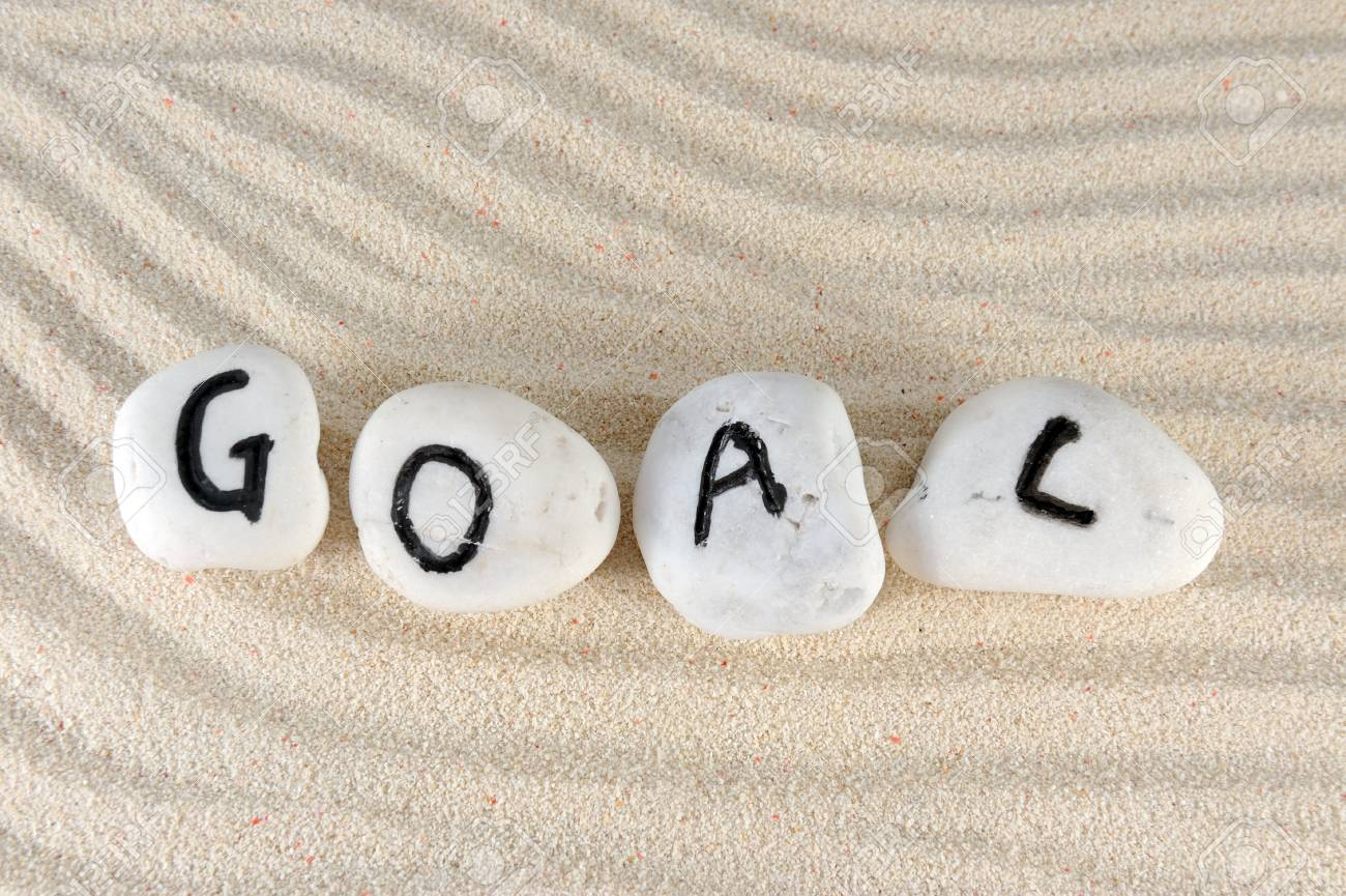 Goal word on group of stones on the sand Stock Photo - 13690962