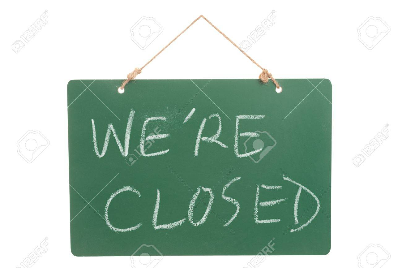 We're closed words on green board hanging and isolated on white Stock Photo - 15238800
