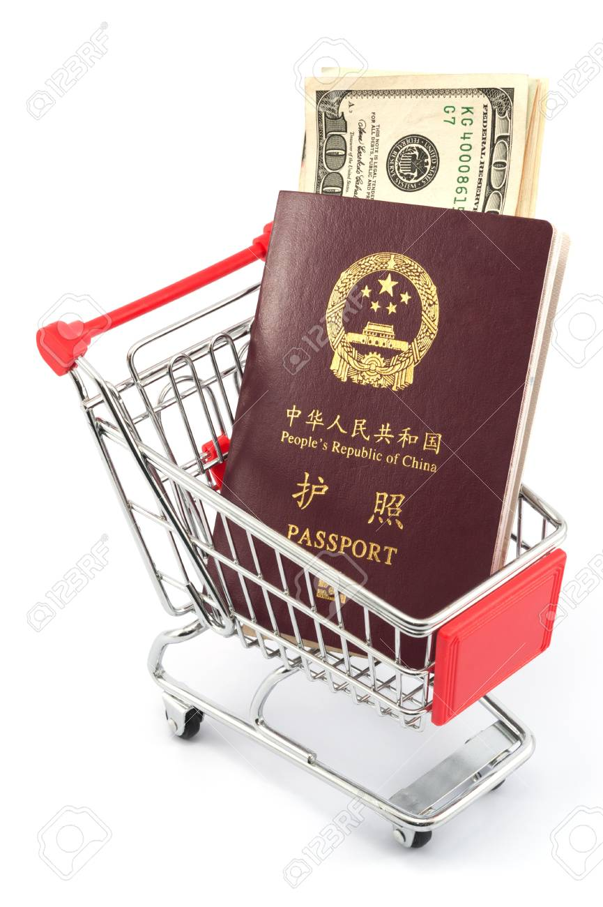 Shopping cart with chinese passport and dollars on white background Stock Photo - 17385420