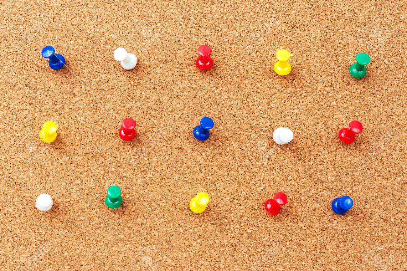 Group of thumbtacks pinned on corkboard Stock Photo - 18656884