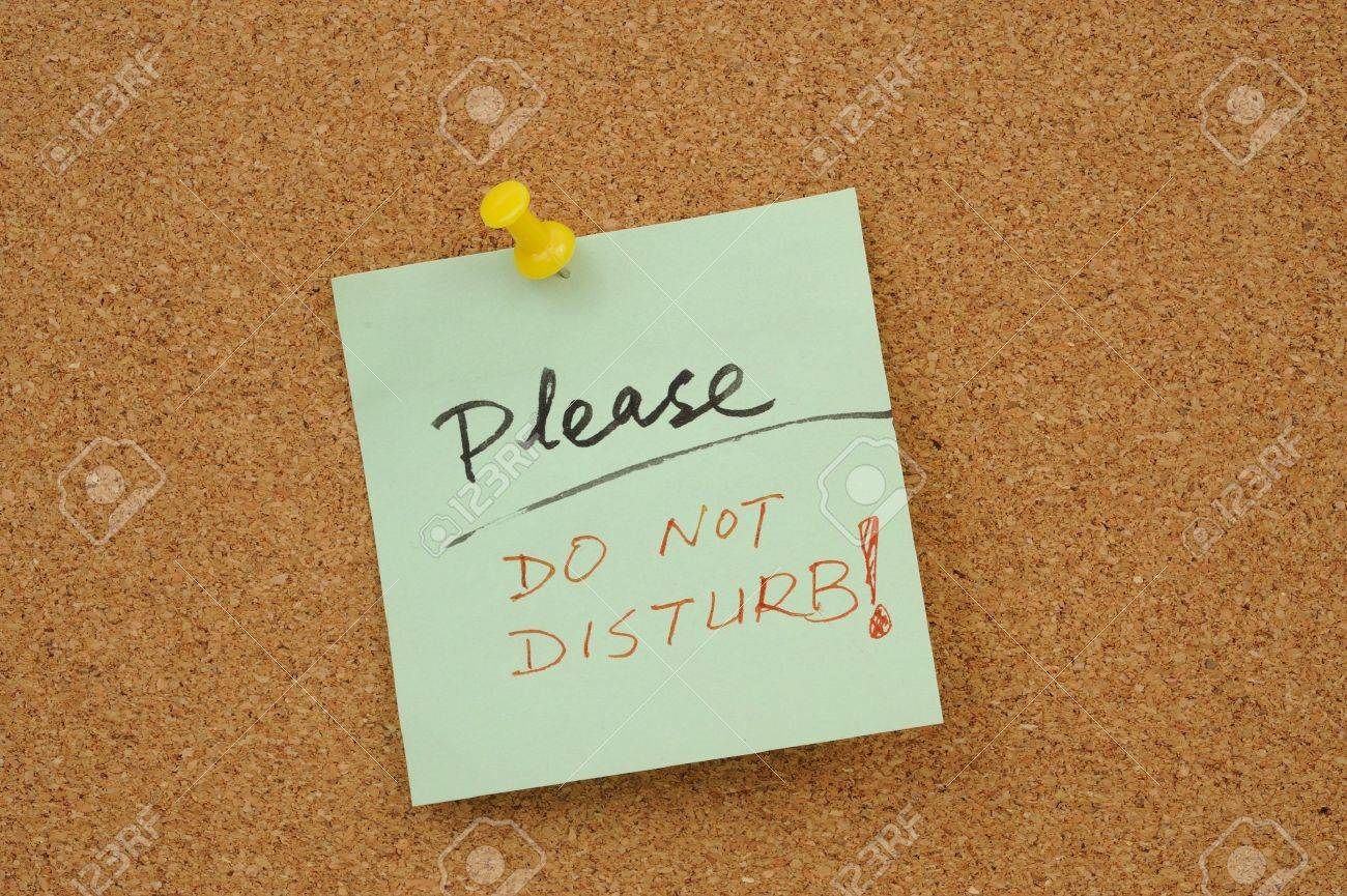 Please do not disturb words written on paper and pinned on corkboard Stock Photo - 18656760