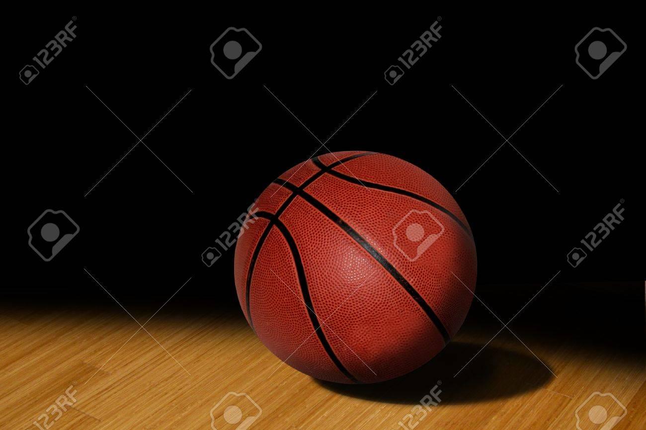 basketball in the spotlight on the floor - 10284615