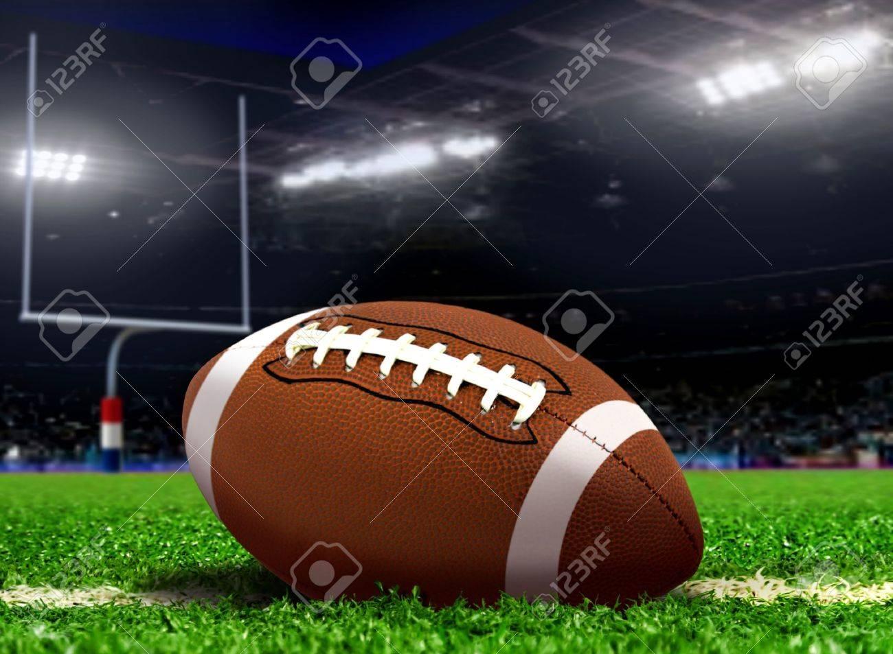 Football Ball on Grass in Stadium - 31819022