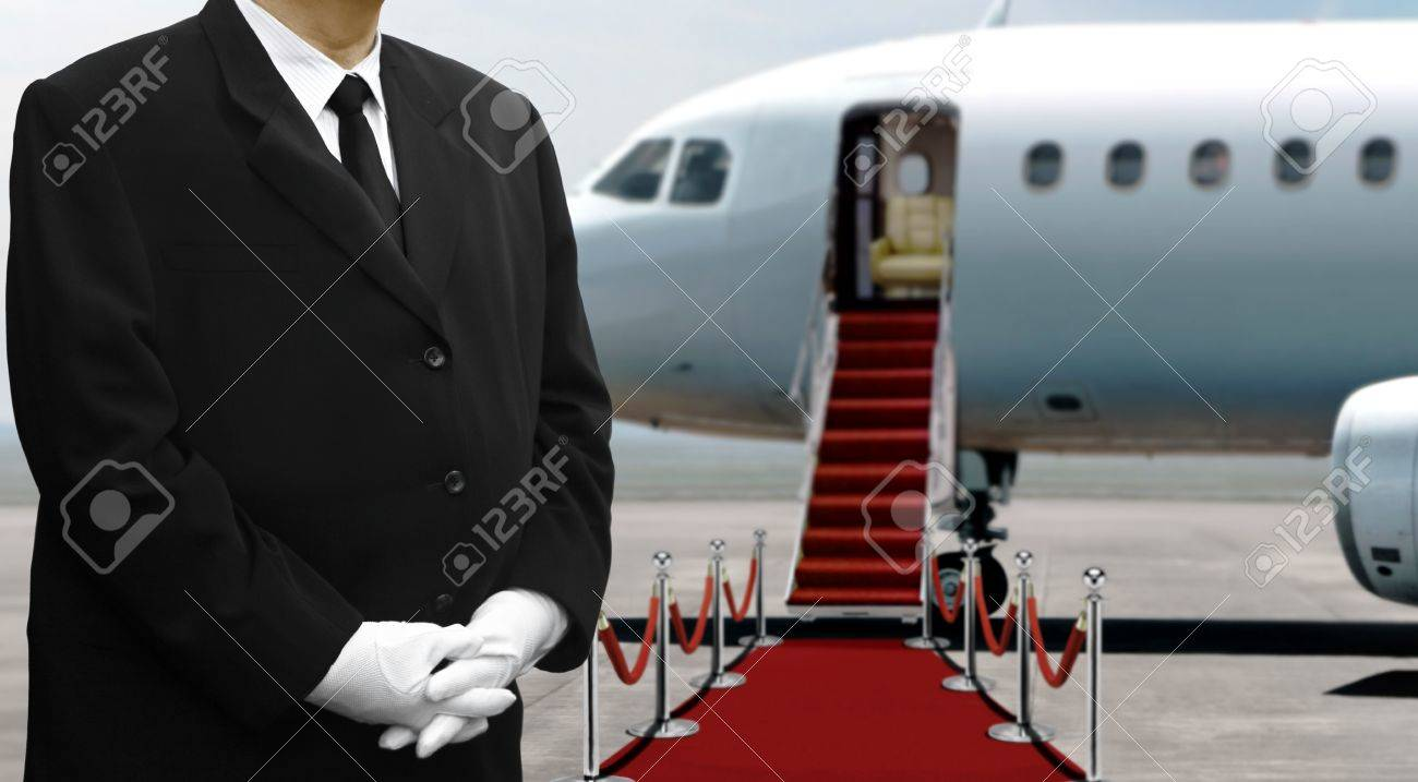 Airplane pilot standing on red carpet before departure - 75242845