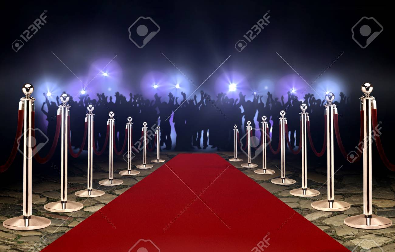 Red carpet between rope barriers and crowd - 88471295