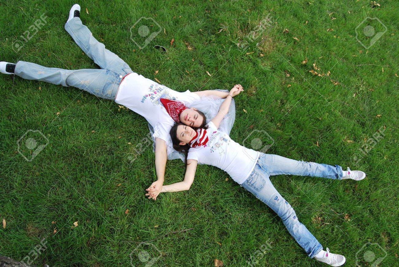 Just married couple dreaming on the grass Stock Photo - 7903732