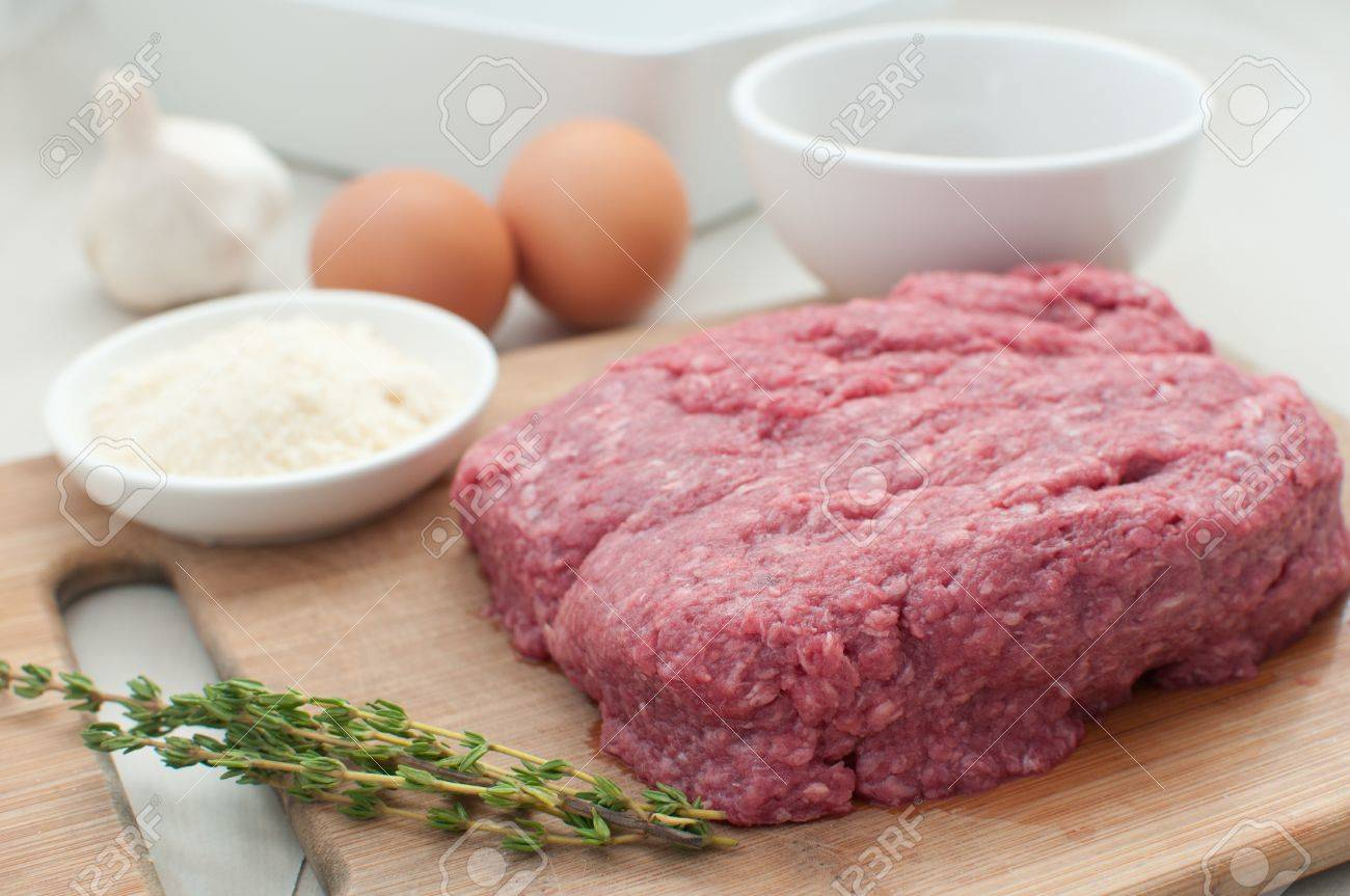 Raw ground meat with eggs and components for cooking horizontal Stock Photo - 16114186
