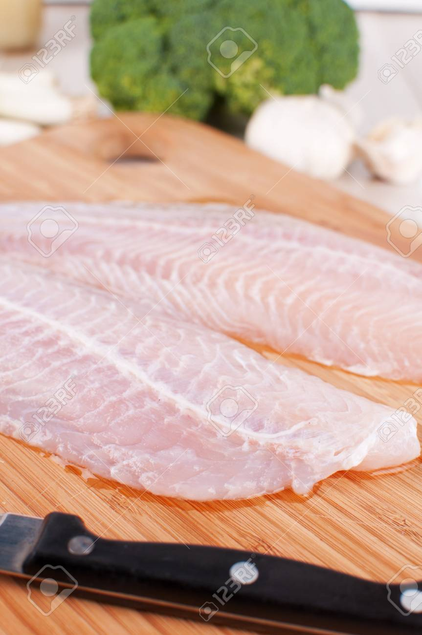Two Raw White Fish Fillet And Knife Vertical Stock Photo Picture And Royalty Free Image Image 17311780