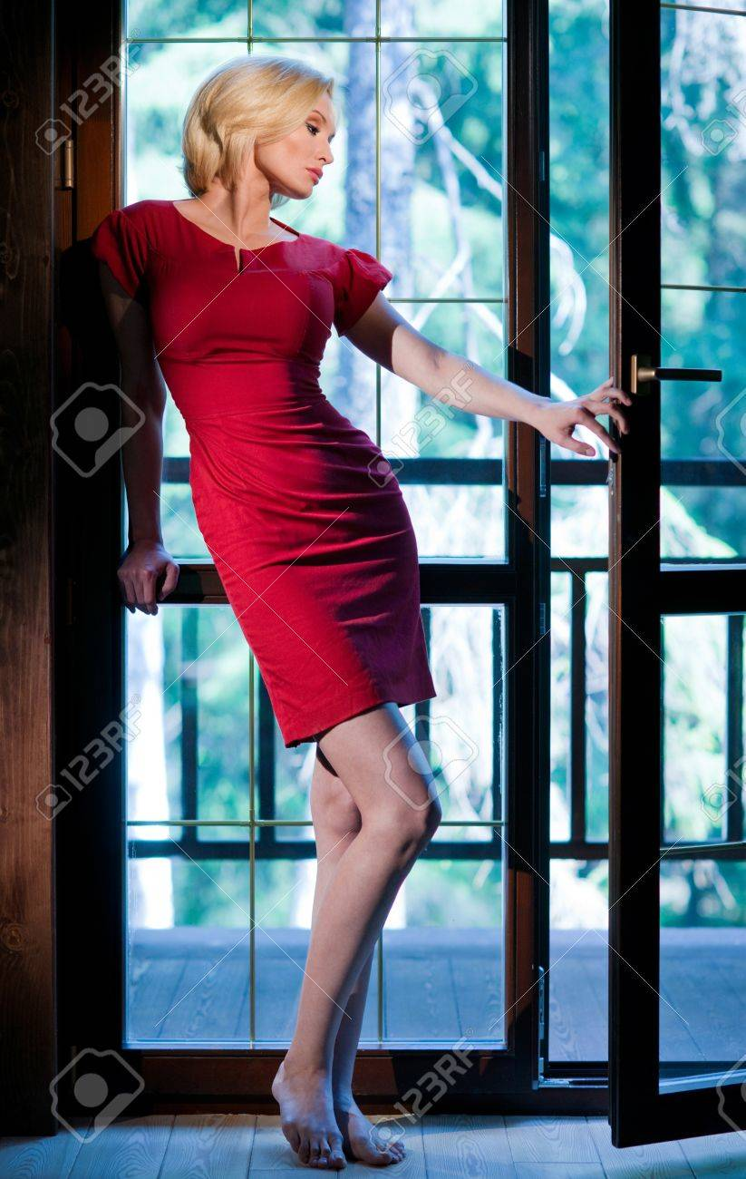 Slender girl by the open window Stock Photo - 14751210