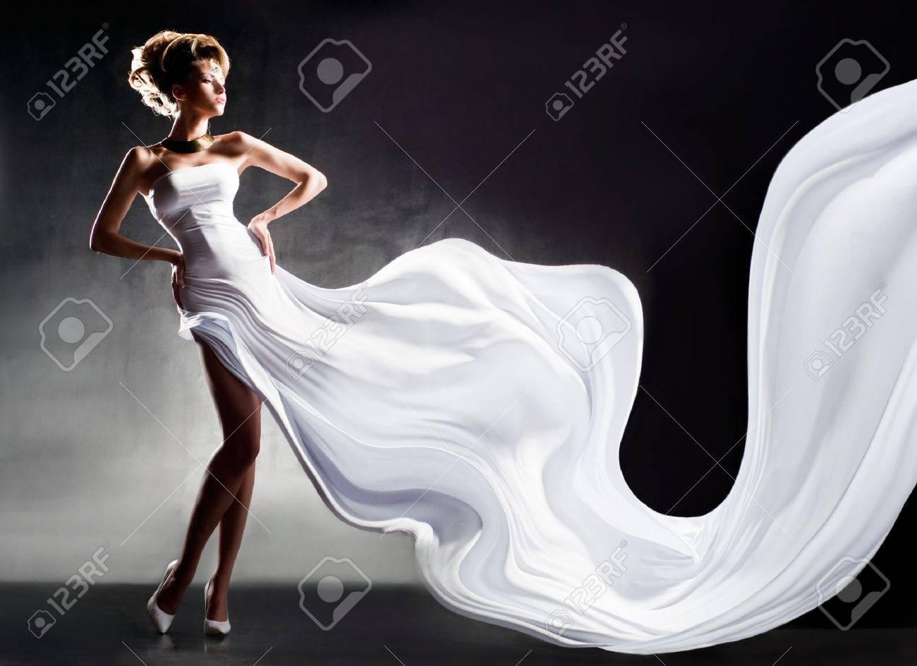 Pretty girl in fluttering white dress Stock Photo - 15155206