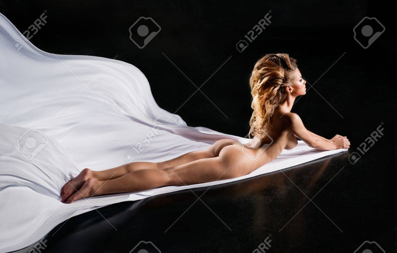 Beautiful sexual girl lies on silk Stock Photo - 15234459