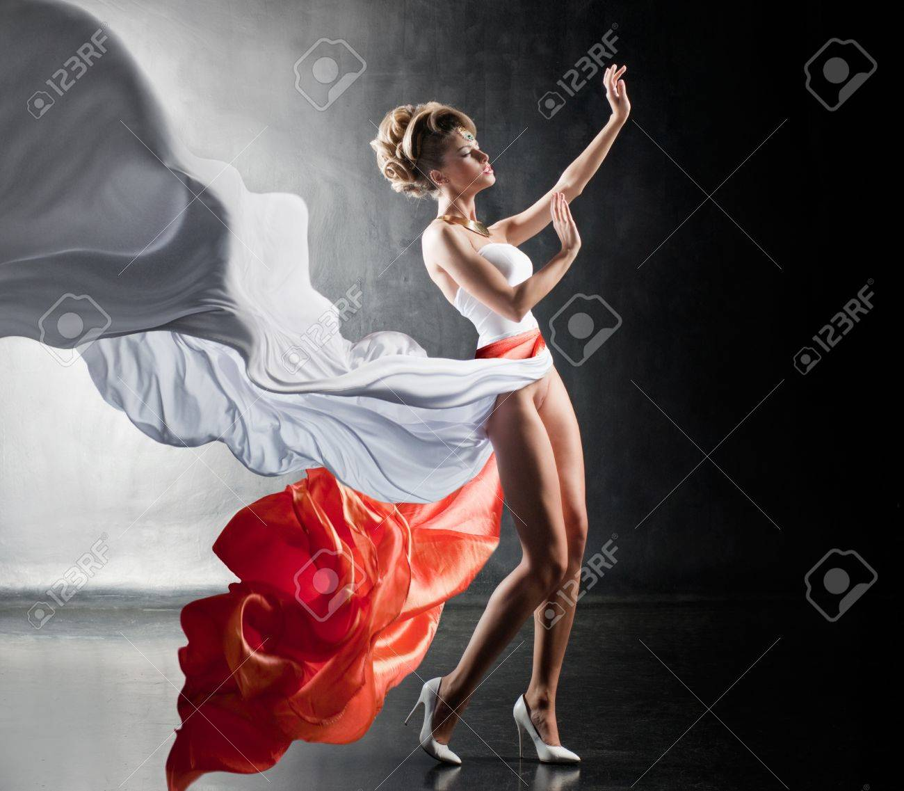 Fantastic sexy girl in fluttering dress Stock Photo - 16465244