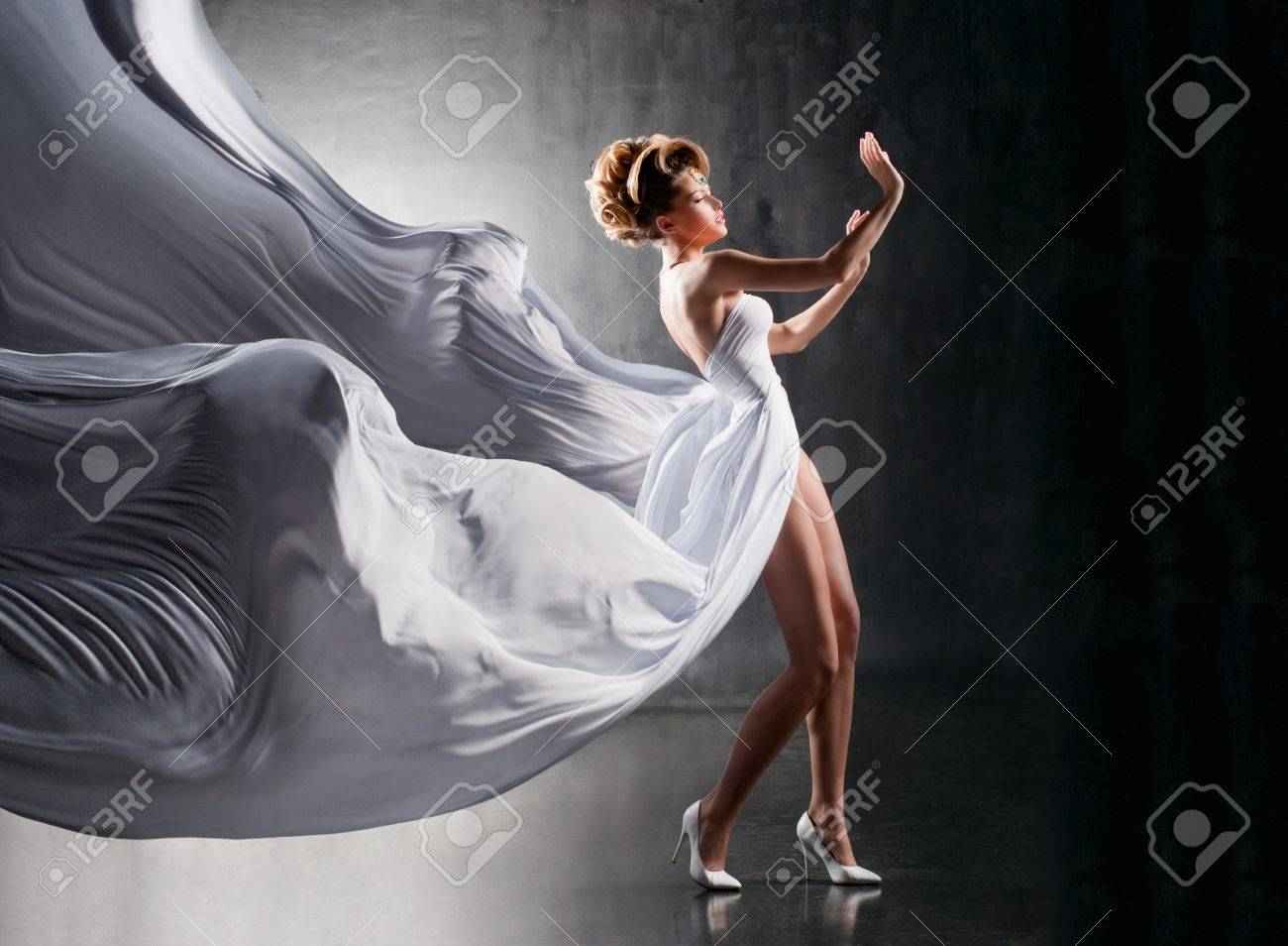Attractive girl in fluttering white dress Stock Photo - 16567412