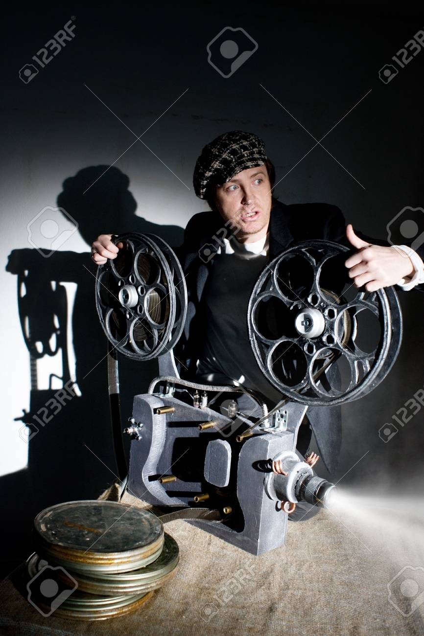 Serious projectionist shows new film Stock Photo - 19264563