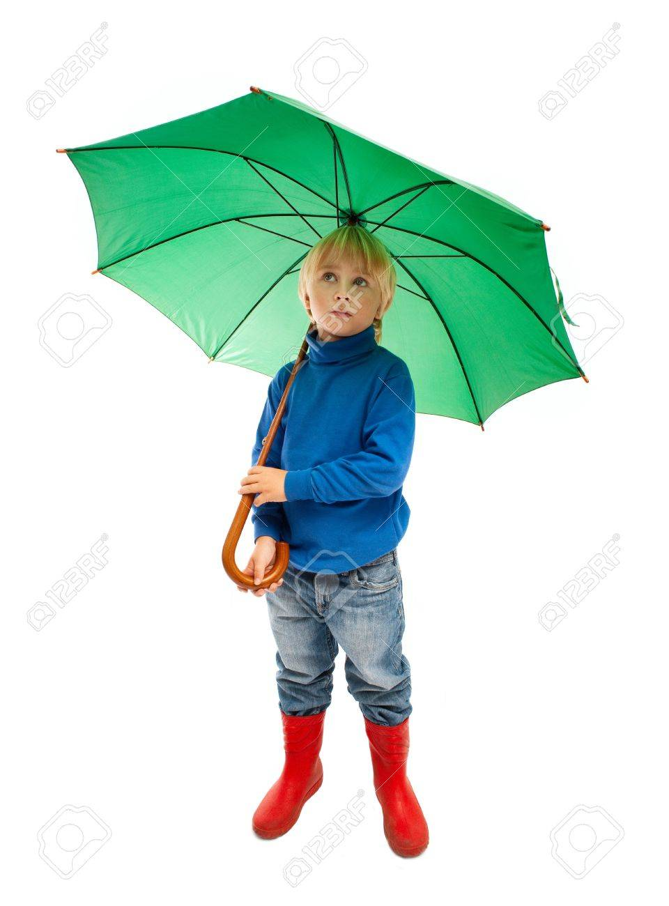 little boy with green umbrella stock photo picture and royalty