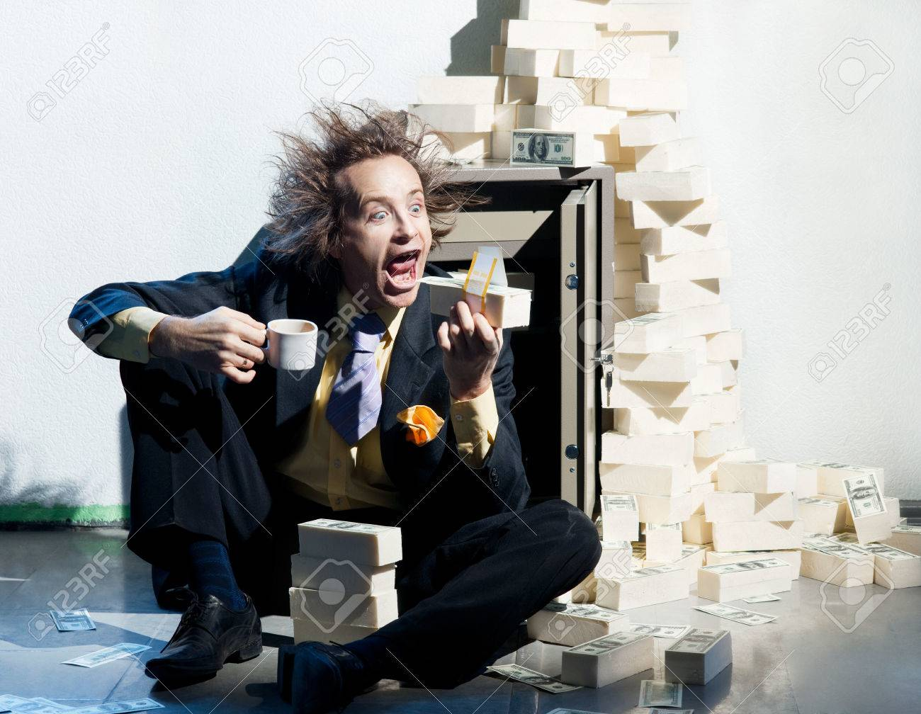 Greedy banker eats a wad of money Stock Photo - 22701371